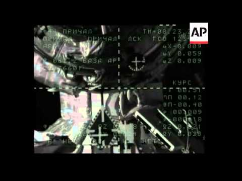 Manned Soyuz spacecraft docks with space station
