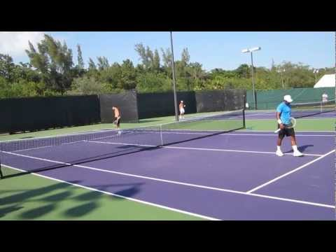 Paes practicing volleys with Llodra
