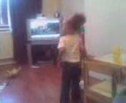 Baby girl doing the okey cokey!