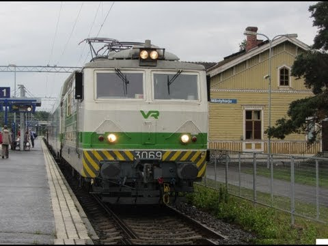 Finland: Two VR Class Sr1 electric loco hauled services pass at Mantyharju (Savonia region) station
