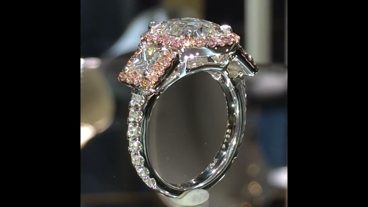 3 carat 3Stone Cushion Diamond Ring in Pink Diamond Halo