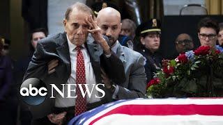 Former Sen. Bob Dole gives final salute as Bush lies in state