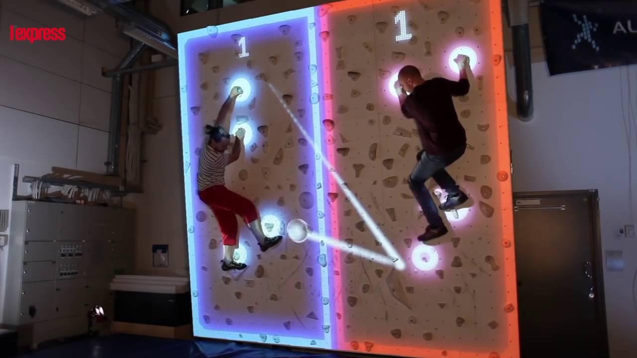 Business Plan Salle D Escalade réalité augmentée: ils jouent à pong sur un mur d'escalade