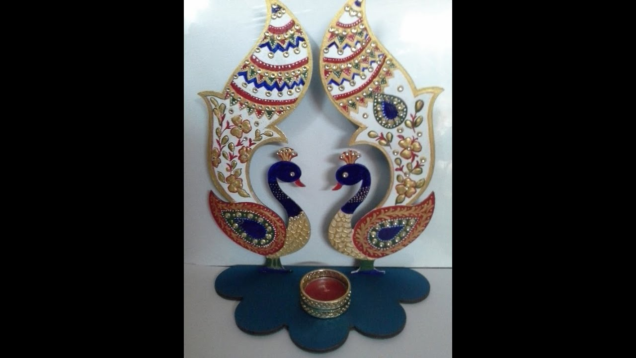 meenakari design painting on a diya stand