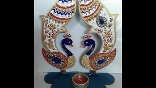 Meenakari design painting on a Diya stand