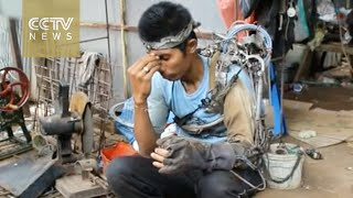 Indonesian man creates a 'robotic arm' from scrap metal