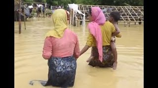 Rohingya Refugees Wade Through Floodwaters in Bangladesh Camp