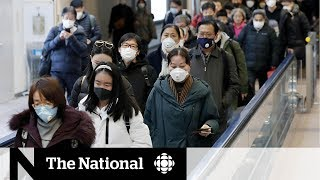 China tightens restrictions on travel as coronavirus spreads