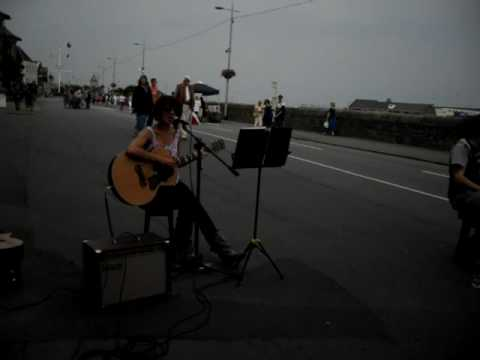 Nessi G performing in Guernsey High Street