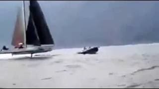 Racing hydrofoil catamaran crashes into RIB