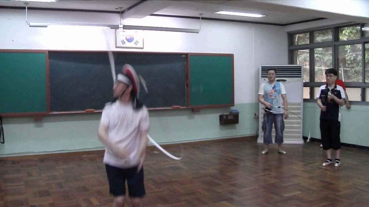 Korean dancing solo in traditional headgear