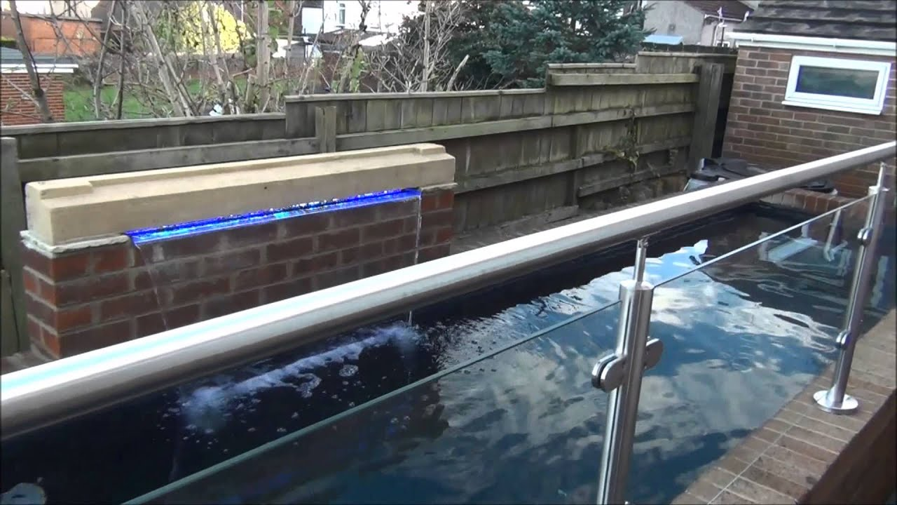 Large koi pond with viewing window pondguru youtube for Koi pond window