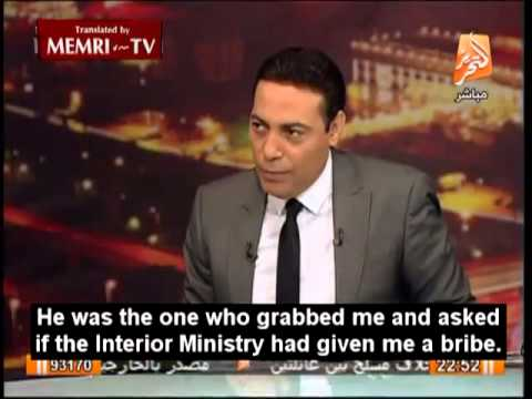 Minister in Morsi's Government Filmed Beating Young Boy during Cairo Muslim Brotherhood Demo