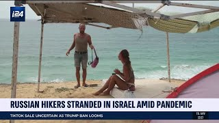 Russian Hitchhiking Duo Stranded In Israel Amid Pandemic