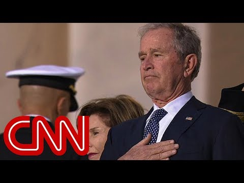 The emotional moment as Bush watches fathers casket enter Capitol