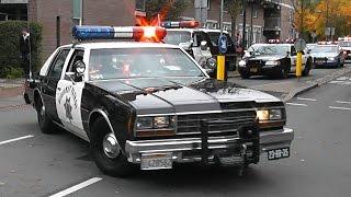 Amerikaanse Politievoertuigen met zwaailicht en sirene in Delft