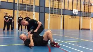 Defense against a knife attack with knee on chest with Amnon Darsa at Institute Krav Maga.