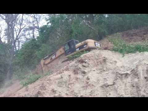 excavator works in dangerous hilly area in nepal
