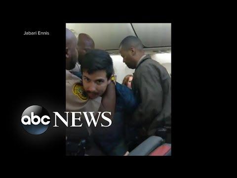 Chaos aboard flight as police use stun gun to arrest, remove passenger