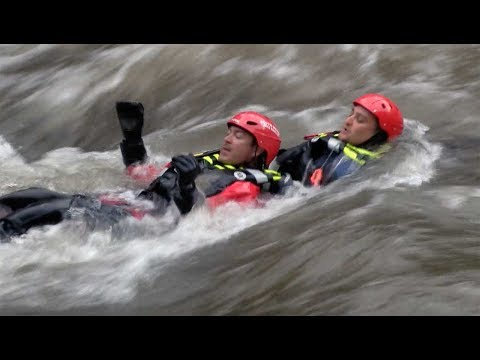 First responders work on swift water rescue techniques on Clear Creek
