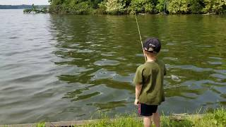 Fishing with Daddy using Grandpas fishing rod