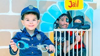 Gleb is a SUPER COP. He closed the criminals in the play house jail.