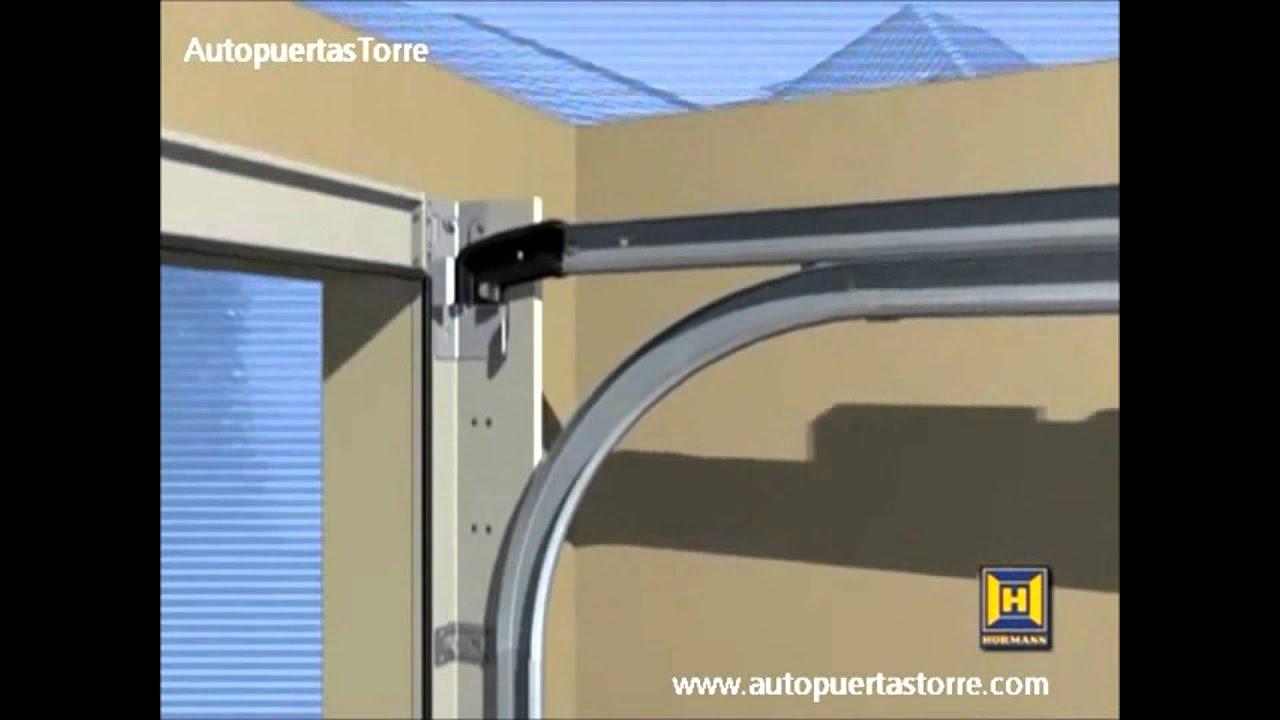 Instalaci n puerta de garaje seccional autopuertastorre - Mecanismo puerta garaje ...