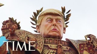 A massive Emperor Trump float presides over an Italian carnival. Not to be taken seriously, of course., From YouTubeVideos