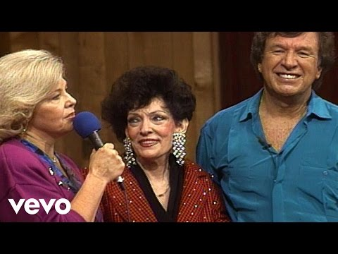 Bill & Gloria Gaither - There's Something About That Name (Live)