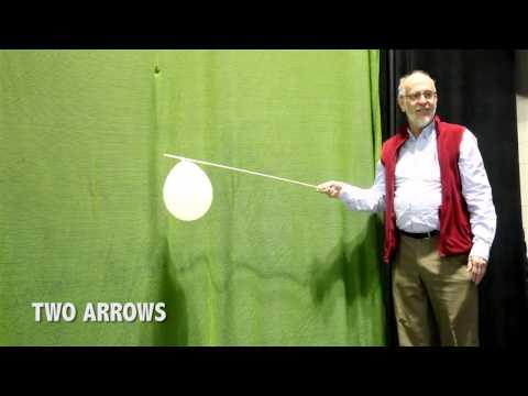 Archer shooting apple off head