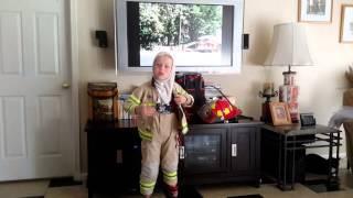 Rescue Riley getting on fireman gear
