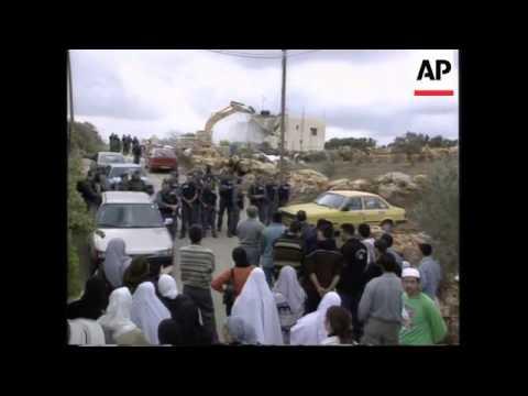 Israeli Bulldozers Demolish Arab Houses