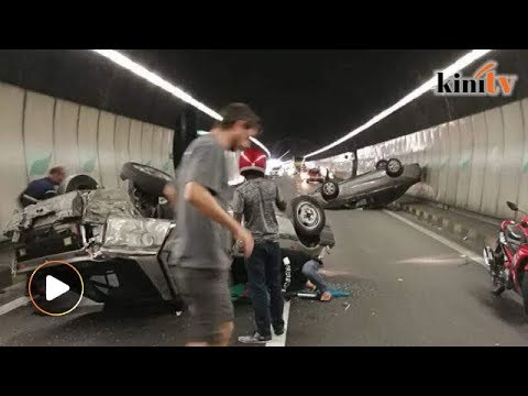 Two cars flipped in Menora Tunnel