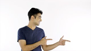 Handsome Indian guy pointing his fingers towards blank copy space for text/image