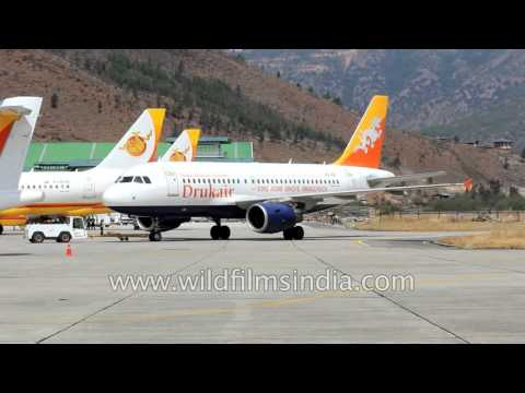 Bhutan has a total of 7 aeroplanes - see passengers disembark at Paro