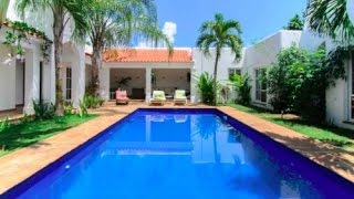 Perfect tropical oasis with pool inside gated beachfront community