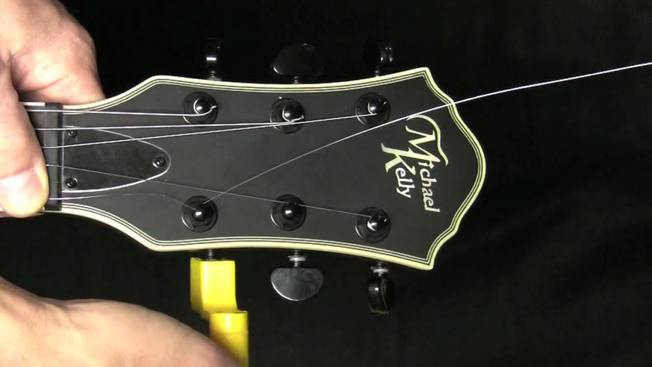 Changing Guitar Strings On An Electric Guitar Youtube