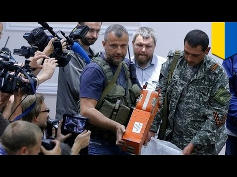 Ukraine rebels turn over bodies and flight recorders from MH17 crash