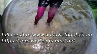 Wet Look 197 girl in wet leather shorts and wet high leather boots in deep water