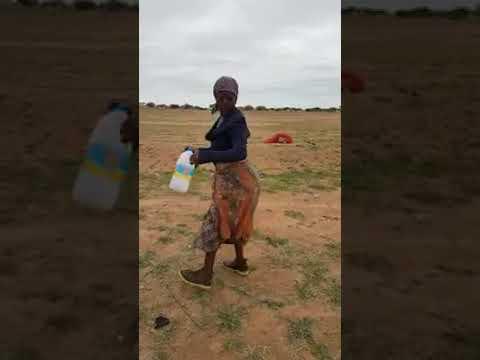 Botswana old woman feeling a song