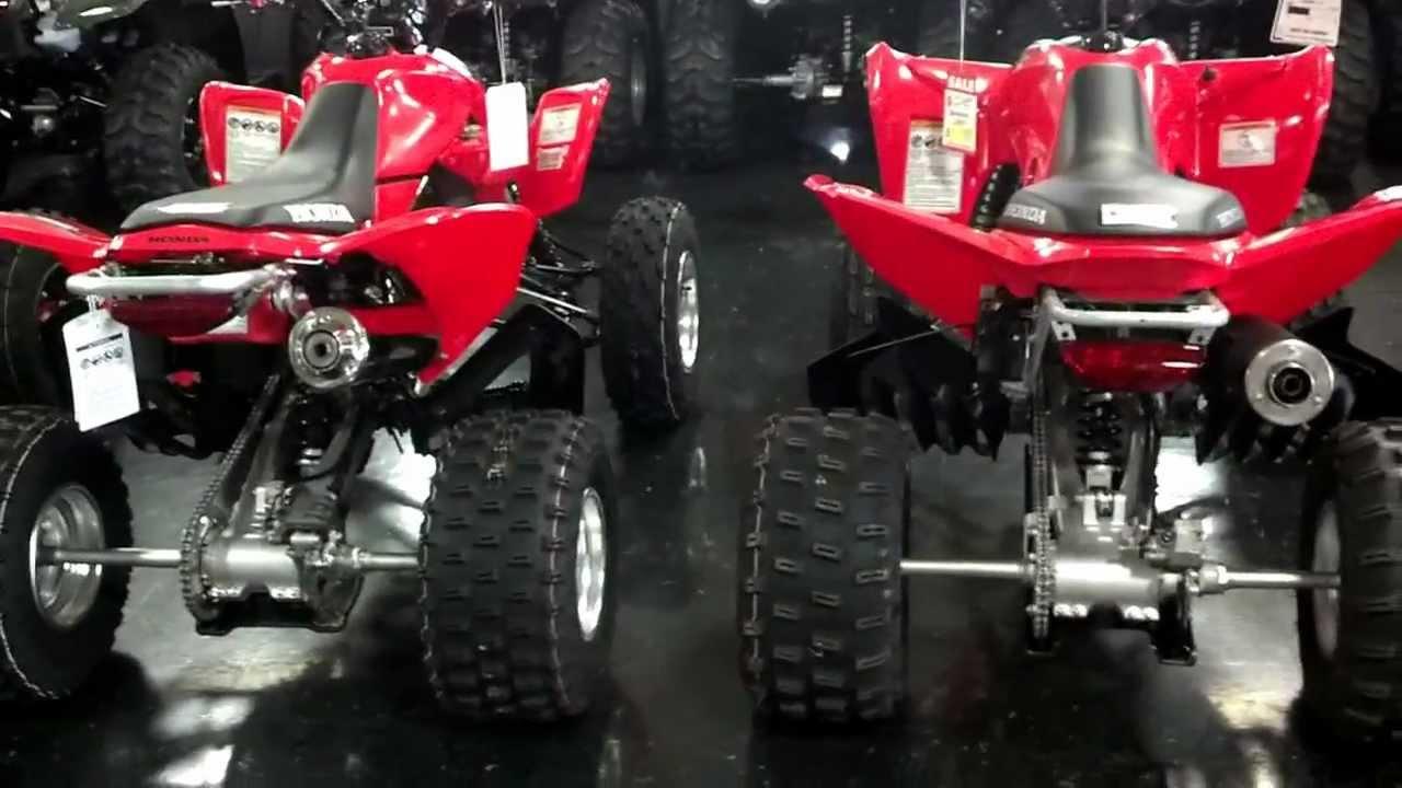 2014 Honda Trx400x Sport Atv Red Black Beside Trx450r At Honda Of