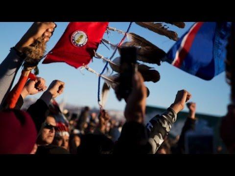 Protesters celebrate pipeline halt