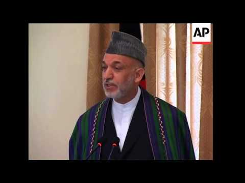 WRAP Afghan president defends vote, admits some bias ADDS bite on 'partial' govt officials
