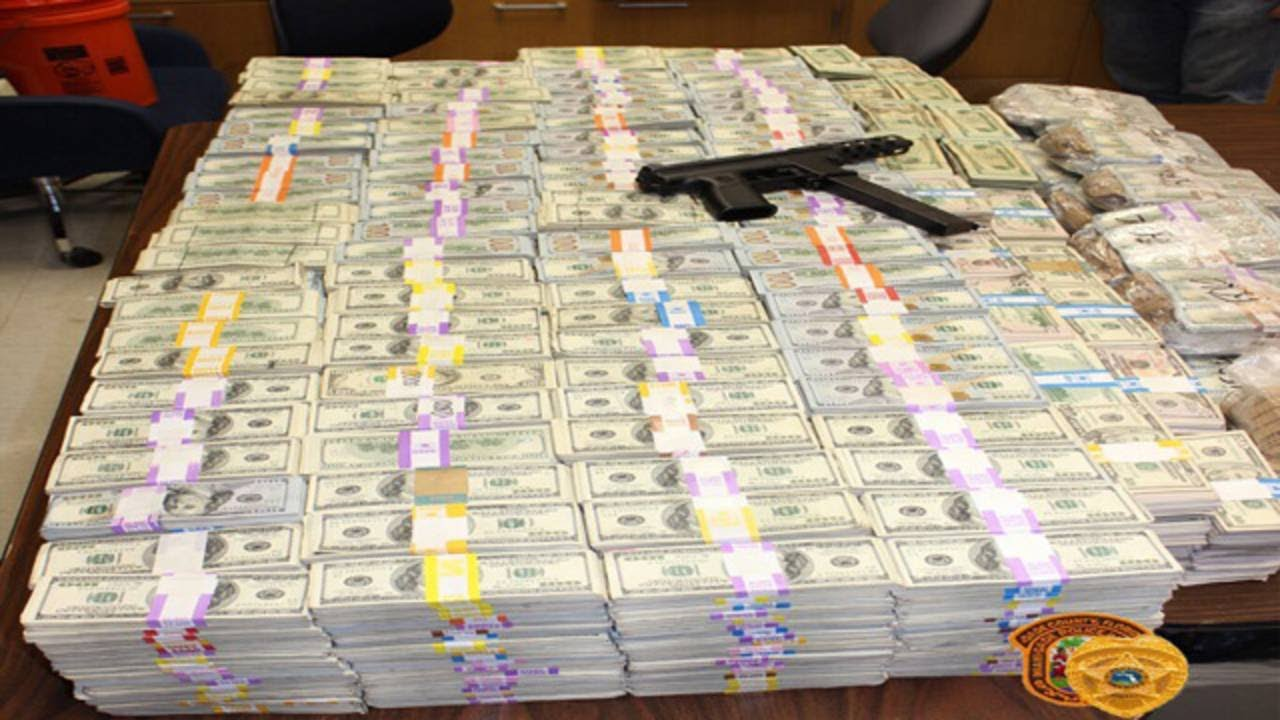 Buckets Of Money Found In Wall Of Home During Drug Bust In