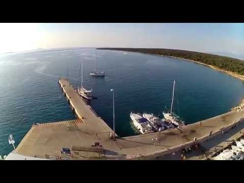 little drone flight around the harbor on island Olib, Croatia