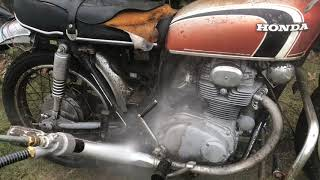 Rusty Motorcycle water blasting