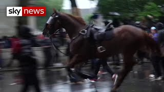 Officer knocked off horse during clash with BLM protesters in London