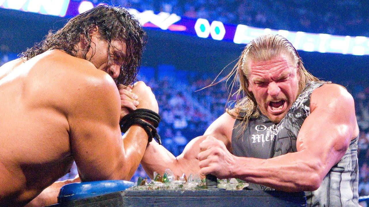 Download Triple H battles The Great Khali in Indian Broken Glass Arm Wrestling match: SmackDown, Aug.8, 2008