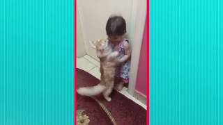 Cat Comforts Baby with a Hug :)