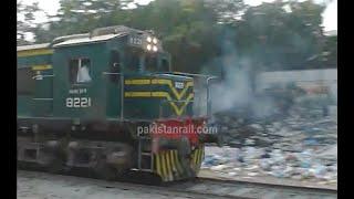 Pakistan Railways Millat Express passing Chanesar Halt in the Karachi Division.
